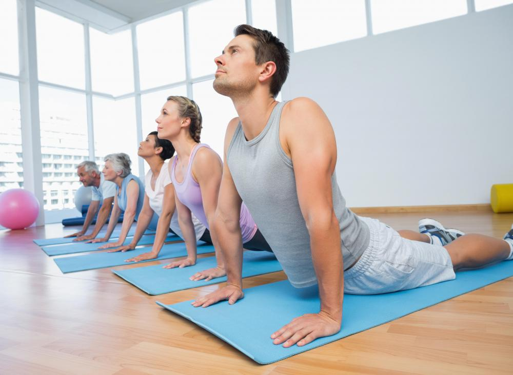 Yoga teachers assist students to ensure that they use proper form and don't injure themselves.