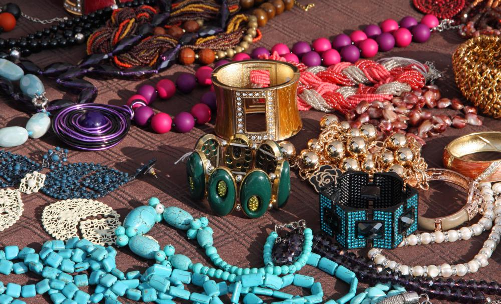 Costume jewelry is usually larger and more colorful than regular jewelry.