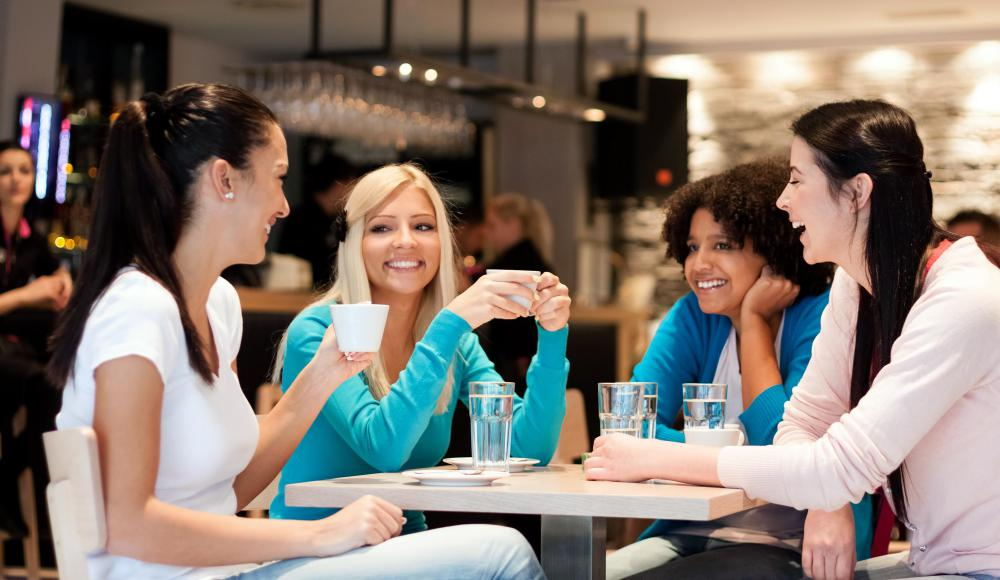 Coffeehouses are a popular place for friends or co-workers to hang out.