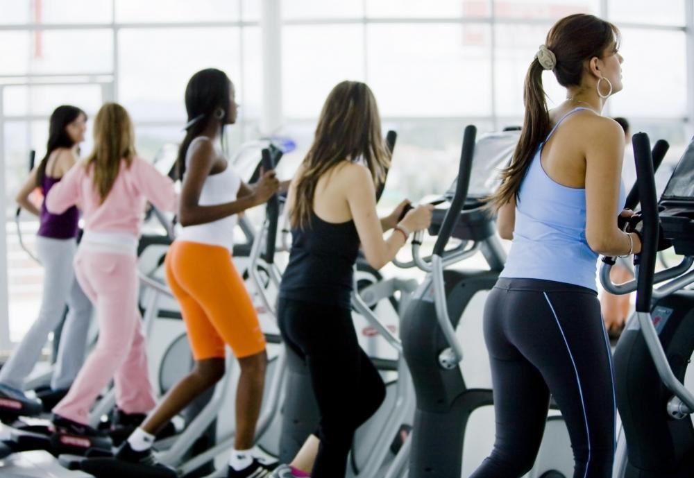 Women on elliptical machines.