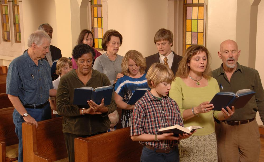 An organist may accompany a church congregation as they sing hymns.