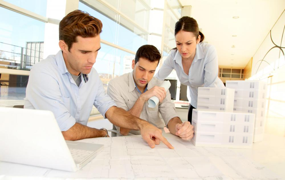 An architectural designer often meets with construction staff and clients to communicate complex ideas.