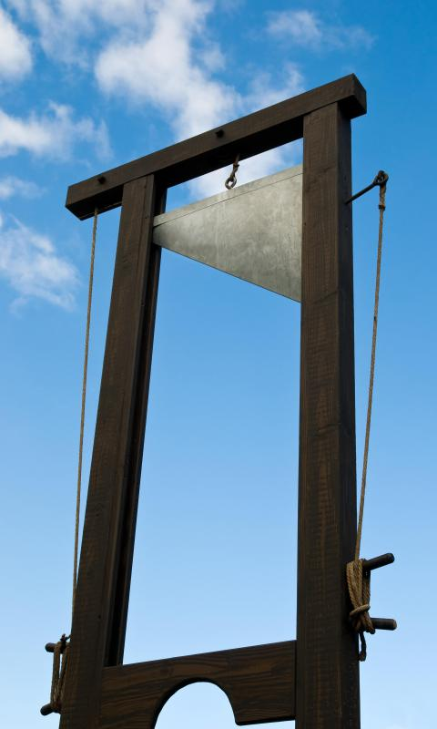 "The guillotine was invented as a quick, accurate way to decapitate a criminal. The euphemistic expression about having your ""head on the block"" suggests similar potentially severe penalties."