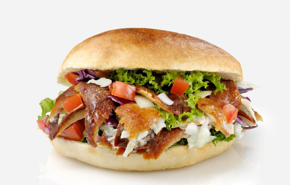 Pita bread, sliced meat, cucumbers, onion, tomato and sauce is often served as street food.