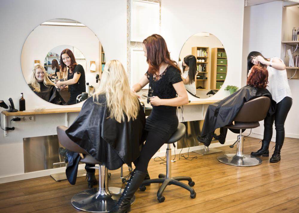 A wash and set is performed in a professional hair salon.