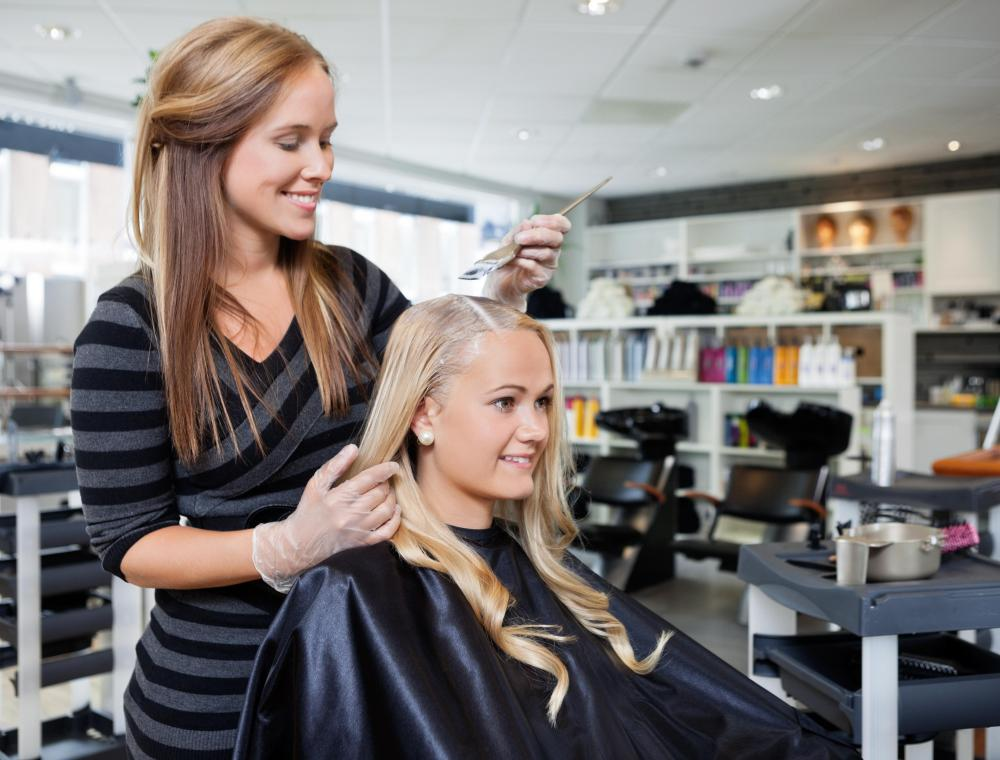 A salon manager hires staff and ensures customers have a good experience.