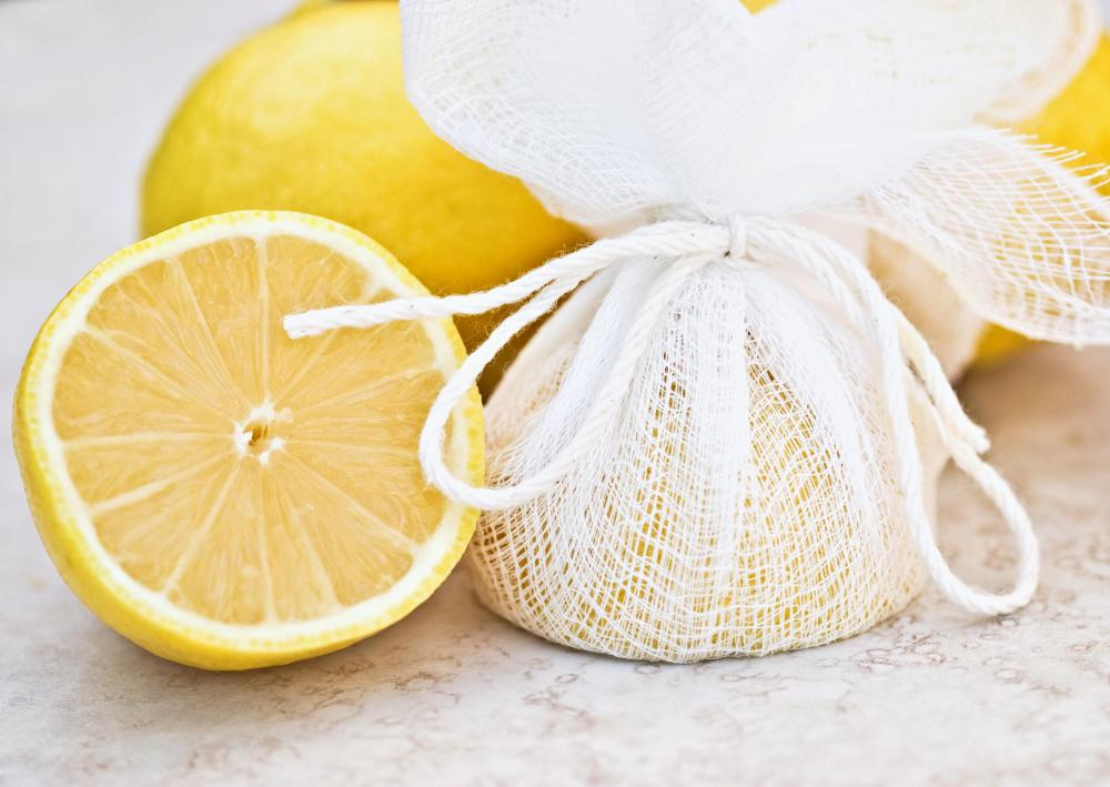 Half a lemon wrapped in cheesecloth.