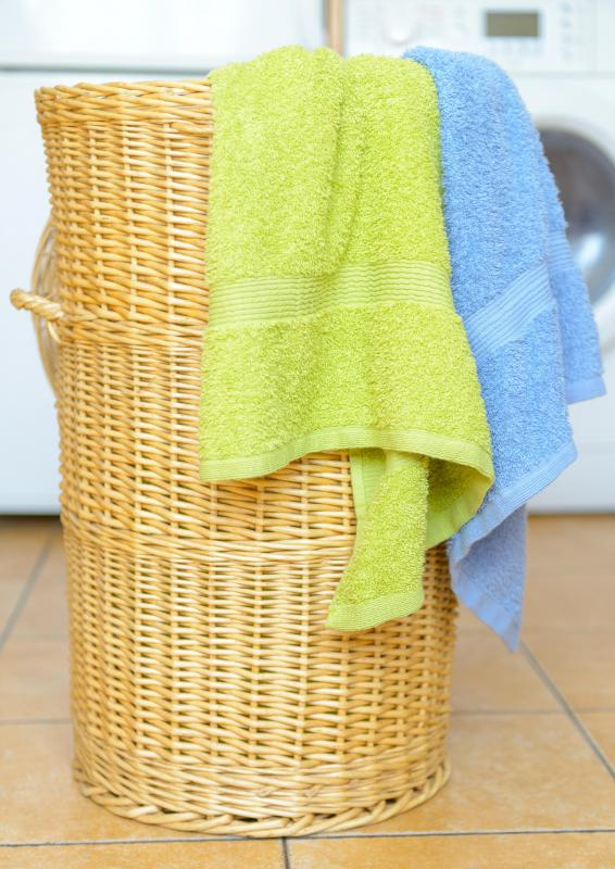 Bringing clothes to a laundromat in a hamper can help keep the area sanitary.