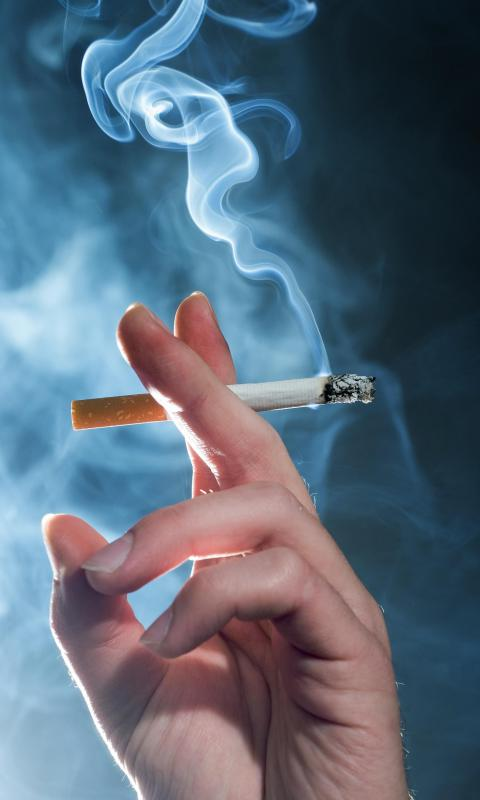 Secondhand smoke rising from a cigarette, which can be filtered by an air filtration system.