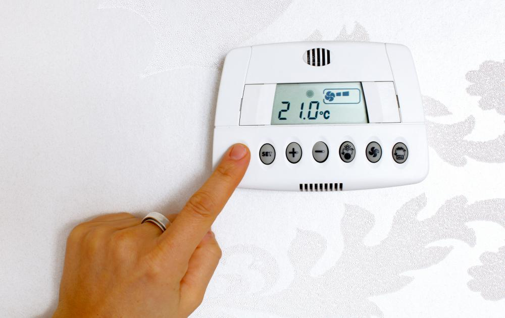 Programmable thermostats can be set to power up before the work day and lower temperatures at night.