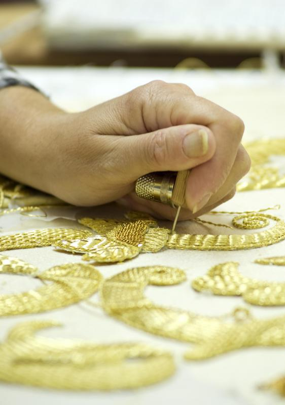 Individuals may perform needlework to create intricate designs on cloth surfaces.