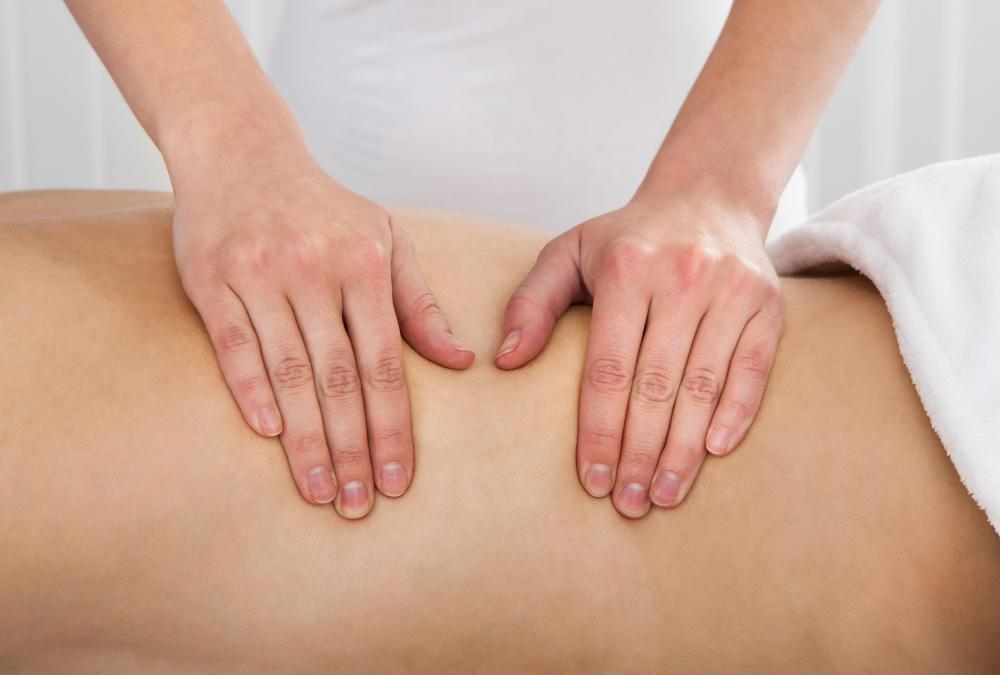 Hand pressure being applied in a Shiatsu Massage.