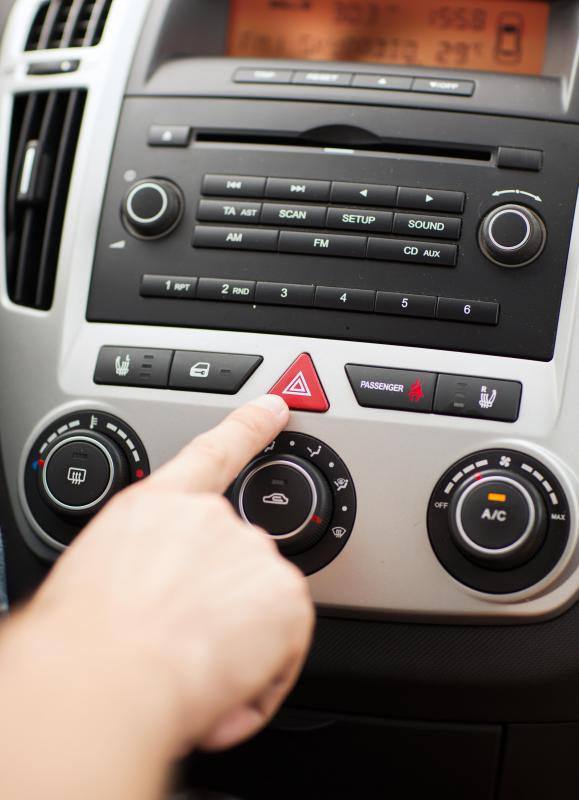 The hazard lights are activated using a button near the steering console.