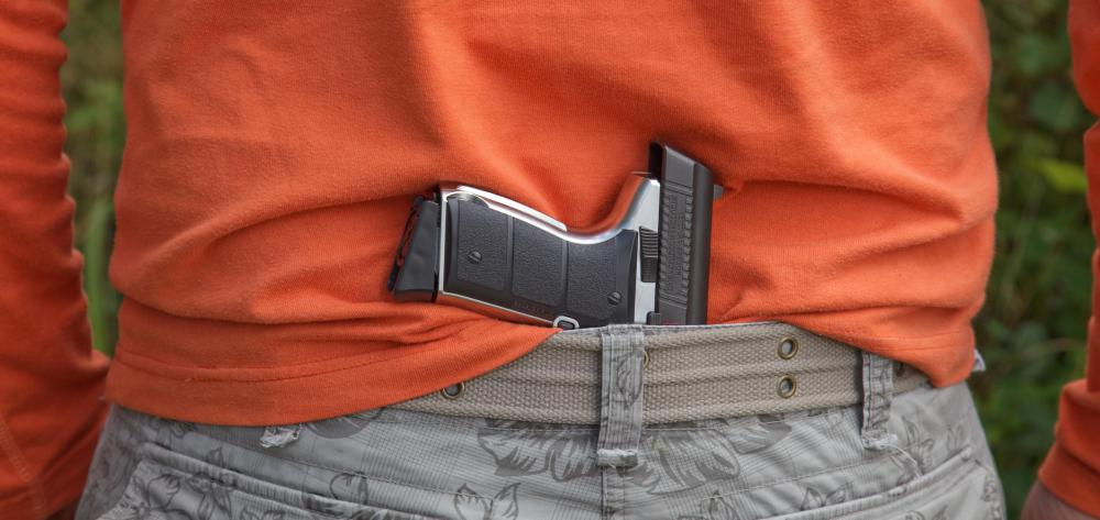Concealed carry permits require weapons not to be visible.