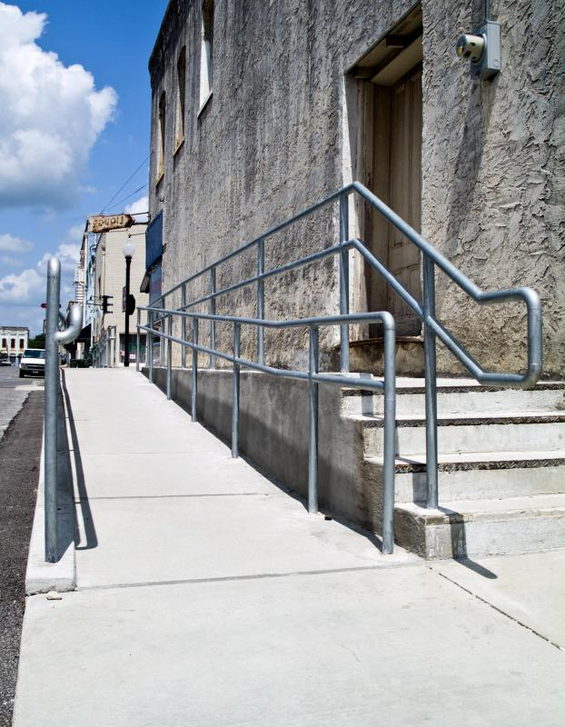 A building surveyor might identify issues with a building like a lack of handicapped access.