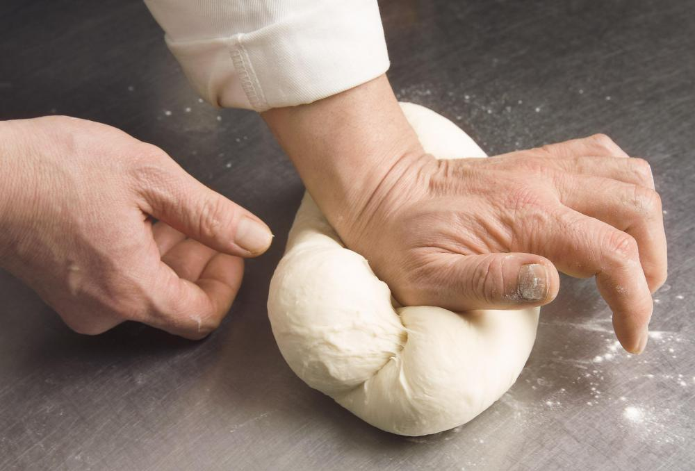 A KitchenAid mixer kneads bread by machine so bakers don't have to do it manually.