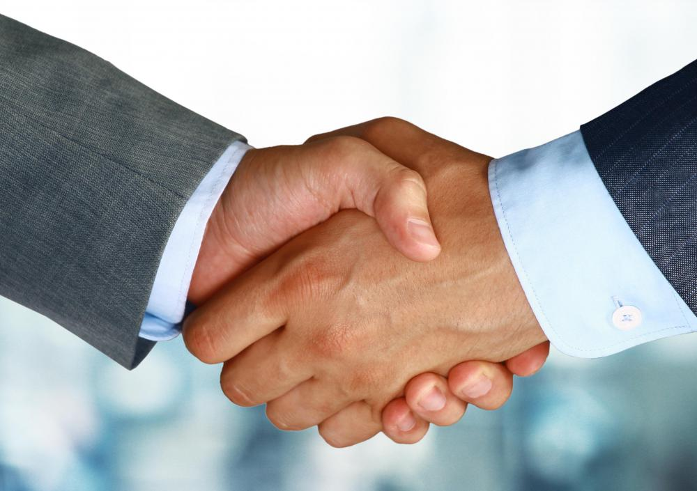 A good way to introduce oneself for an interview is with a confident smile and handshake.