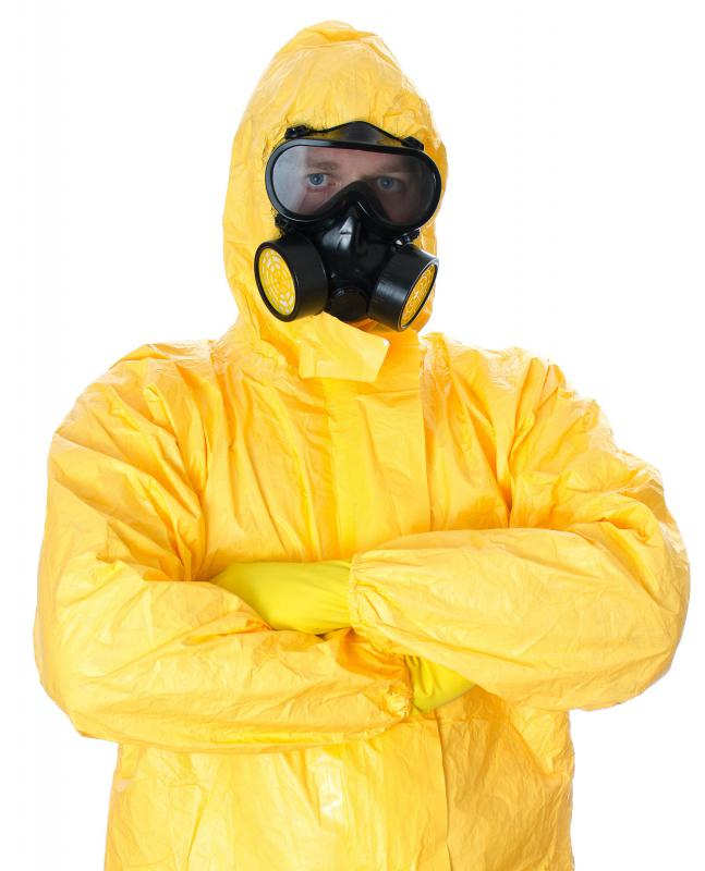 Asbestos removal companies wear appropriate safety gear to avoid exposure to the material.