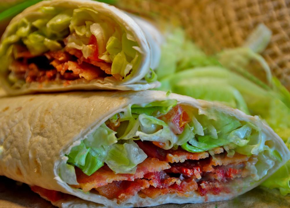 Flour tortillas can be used to make a BLT wrap sandwich made with turkey bacon, lettuce, and tomato.