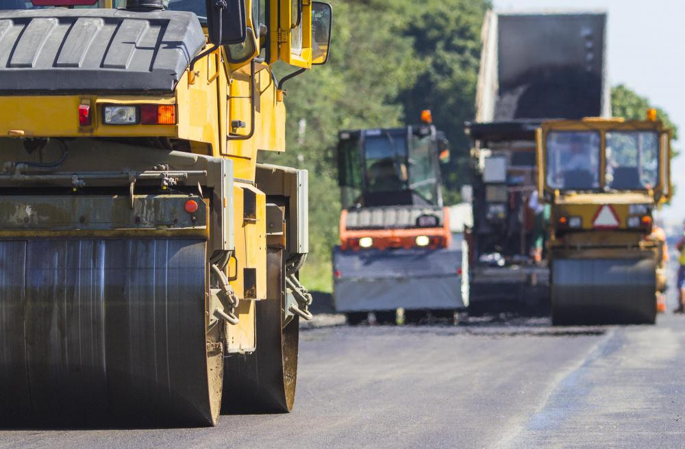 A thin layer of road oil is often used as the last step in paving a new road.