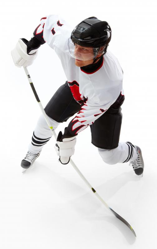 Hockey player wearing player skates.