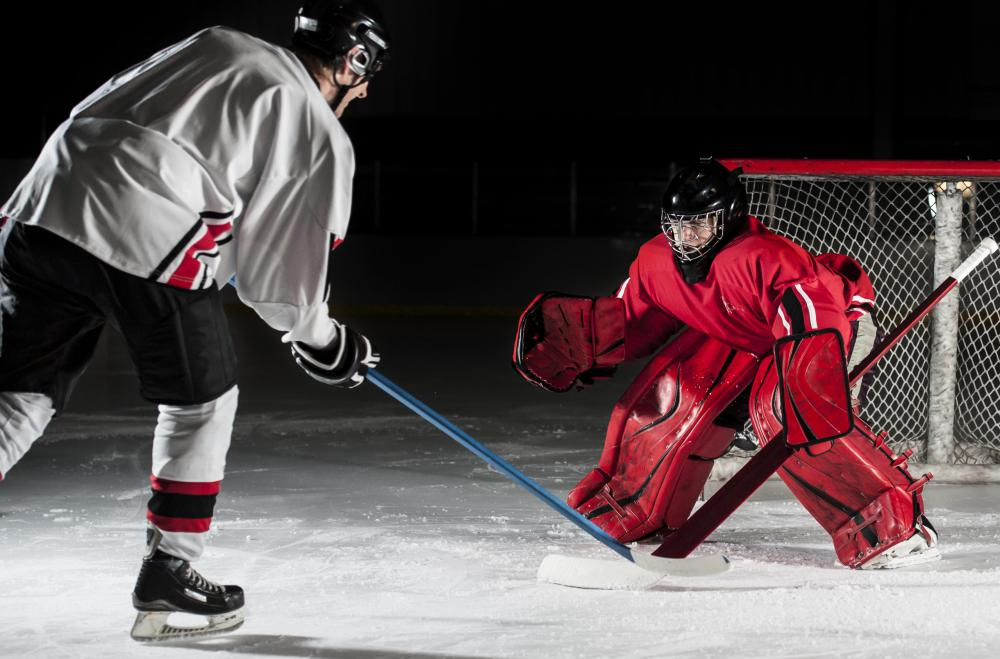 Hockey goaltenders wear much more padding than forwards and defensemen.