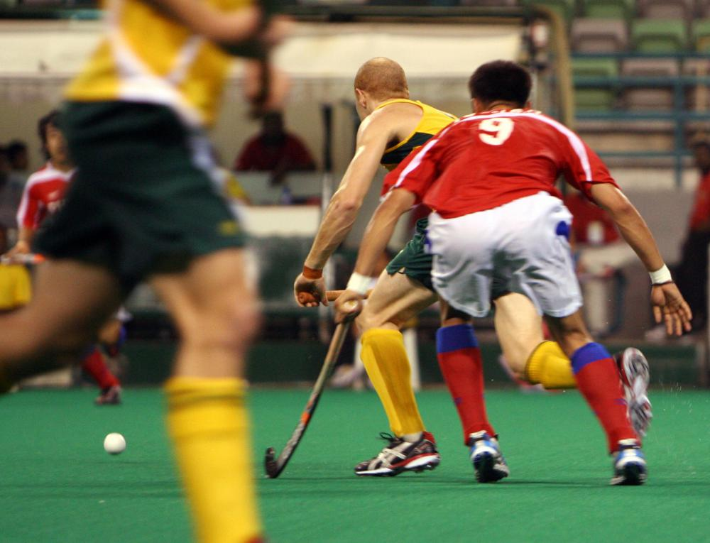 Field hockey players may only strike the ball with the flat part of their stick.