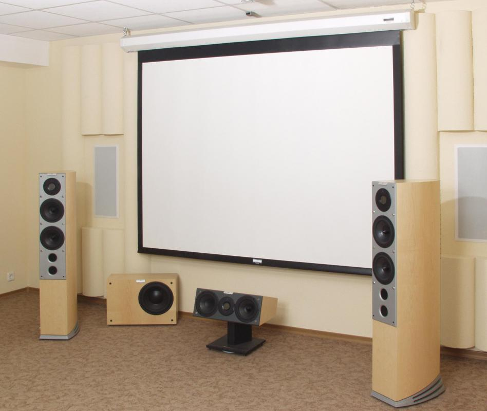 A projection screen and a set of speakers are essential for a home theater.