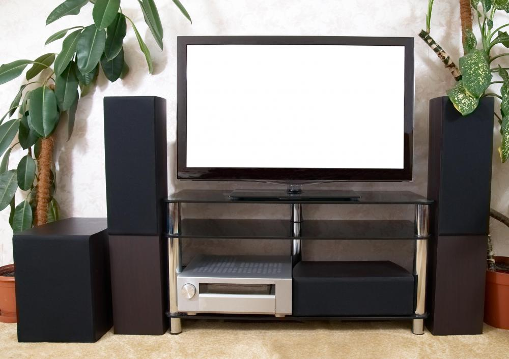 A home theater with a television, receiver, and speakers.