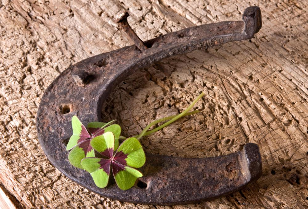 Both horseshoes and four-leaf clovers are considered good luck charms.