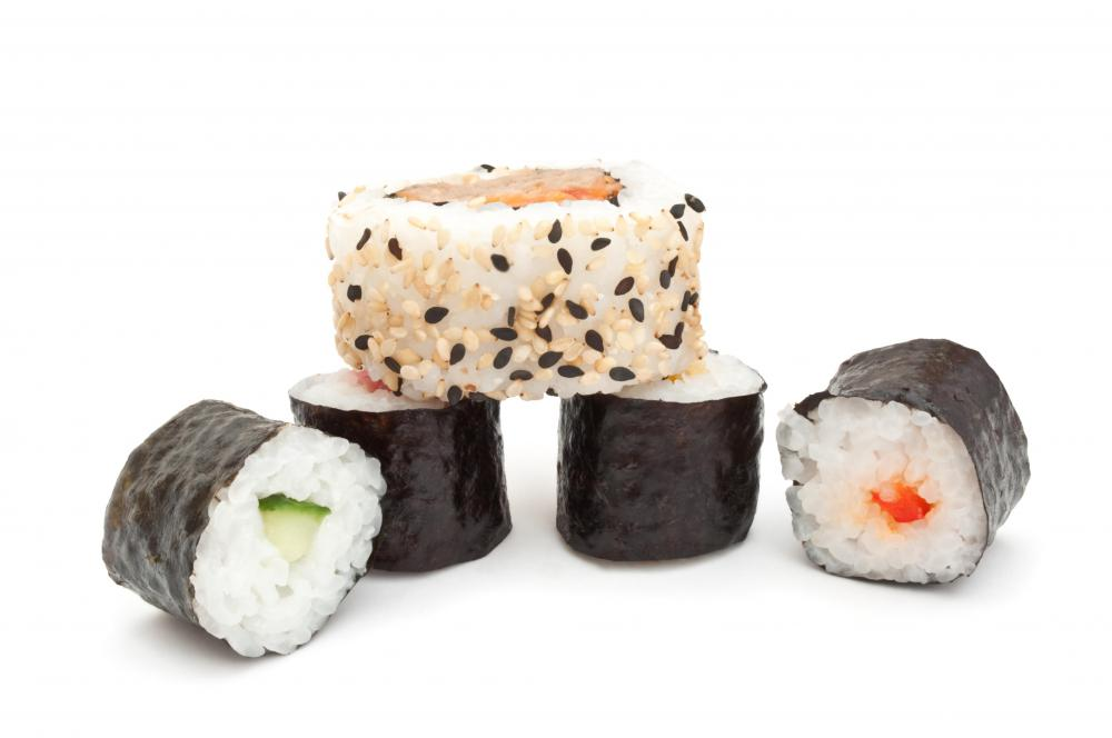 Hosomaki rolls underneath an uramaki roll.