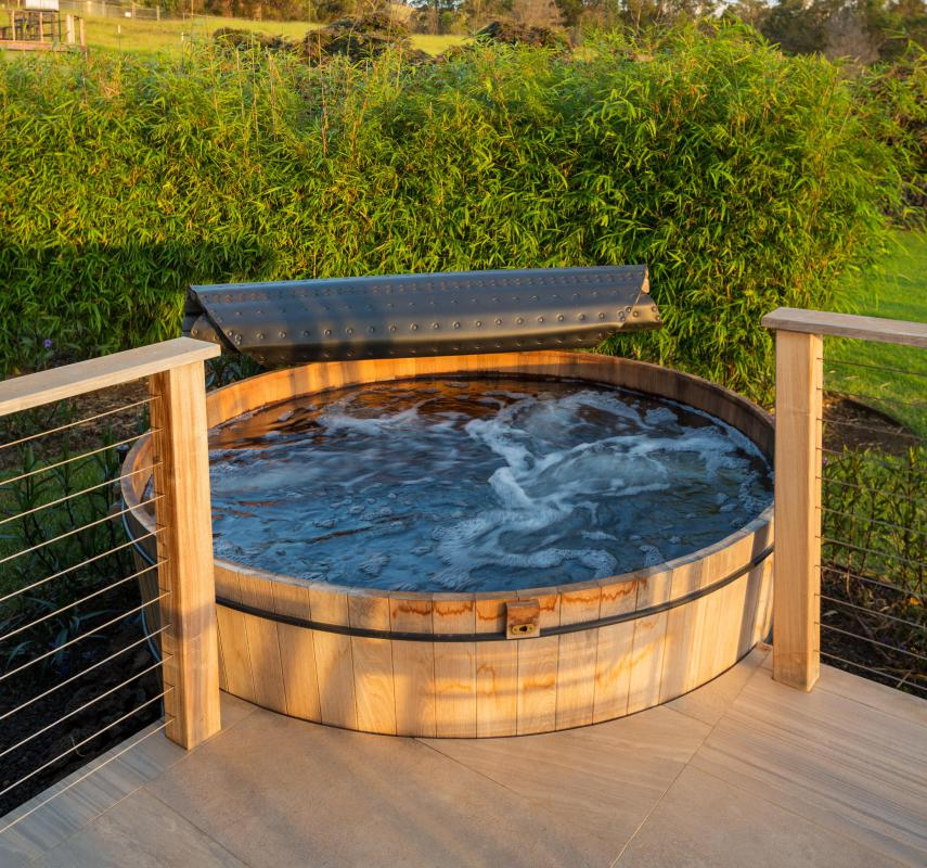 A wood-fired hot tub uses heat from a fire in a stove to warm the water, meaning no electricity is necessary to heat the tub.