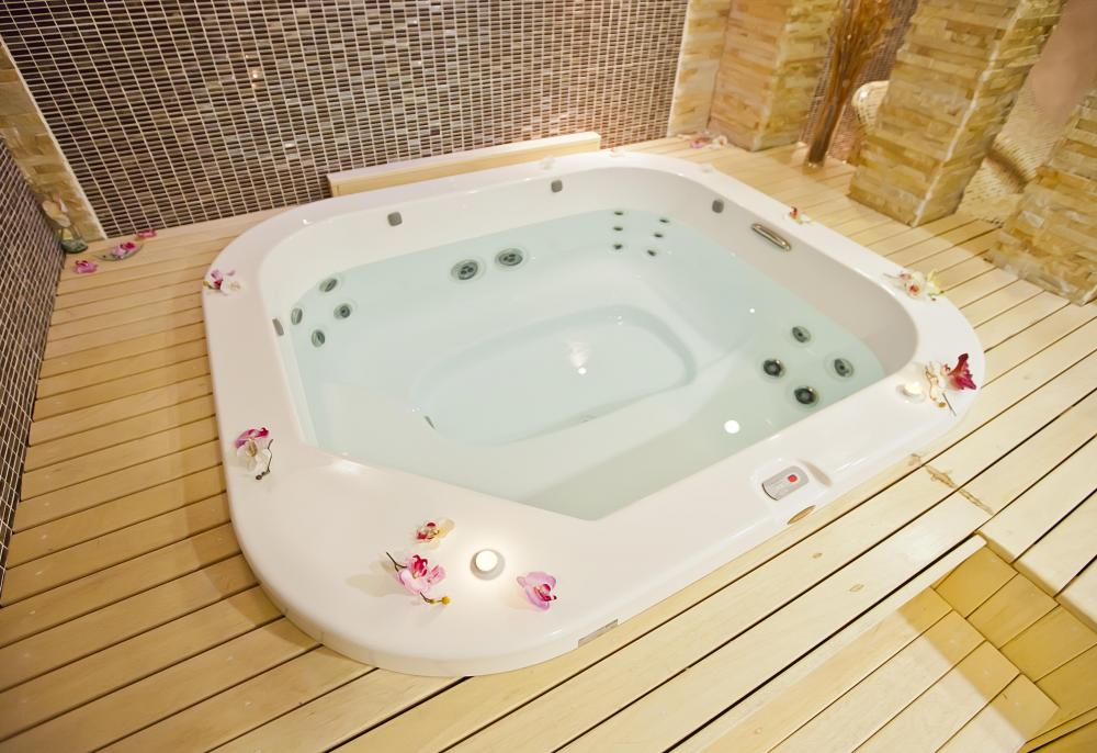 A Water Filled Hot Tub Also Known As Jacuzzi