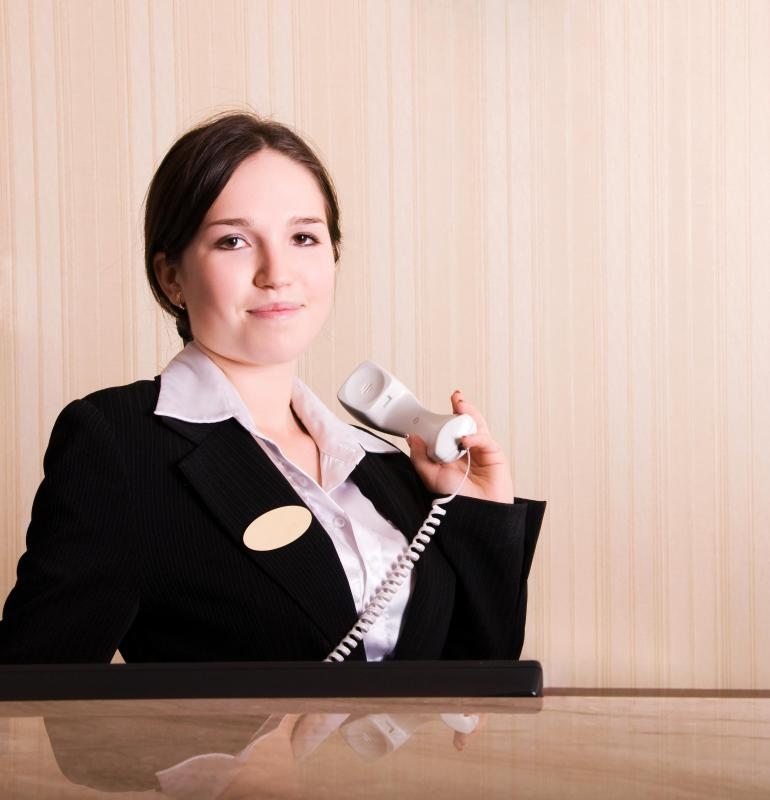 Front desk hotel workers are responsible for keeping track of reservations.