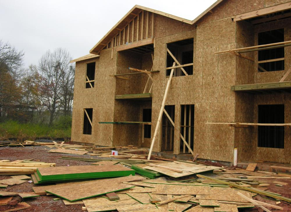 Plywood can be very strong if constructed properly, and is commonly used in the construction of houses.