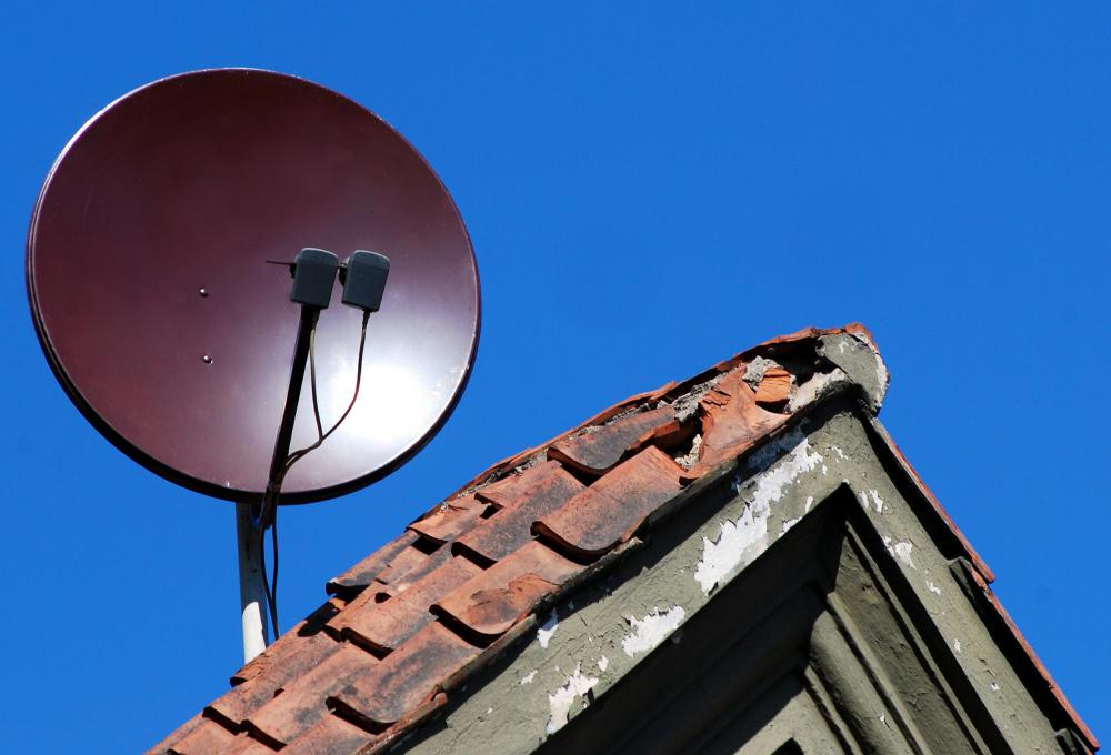 A broadband installer may install small satellite receiver dishes.