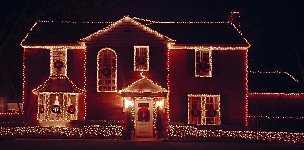 A house decorated with Christmas wreaths.