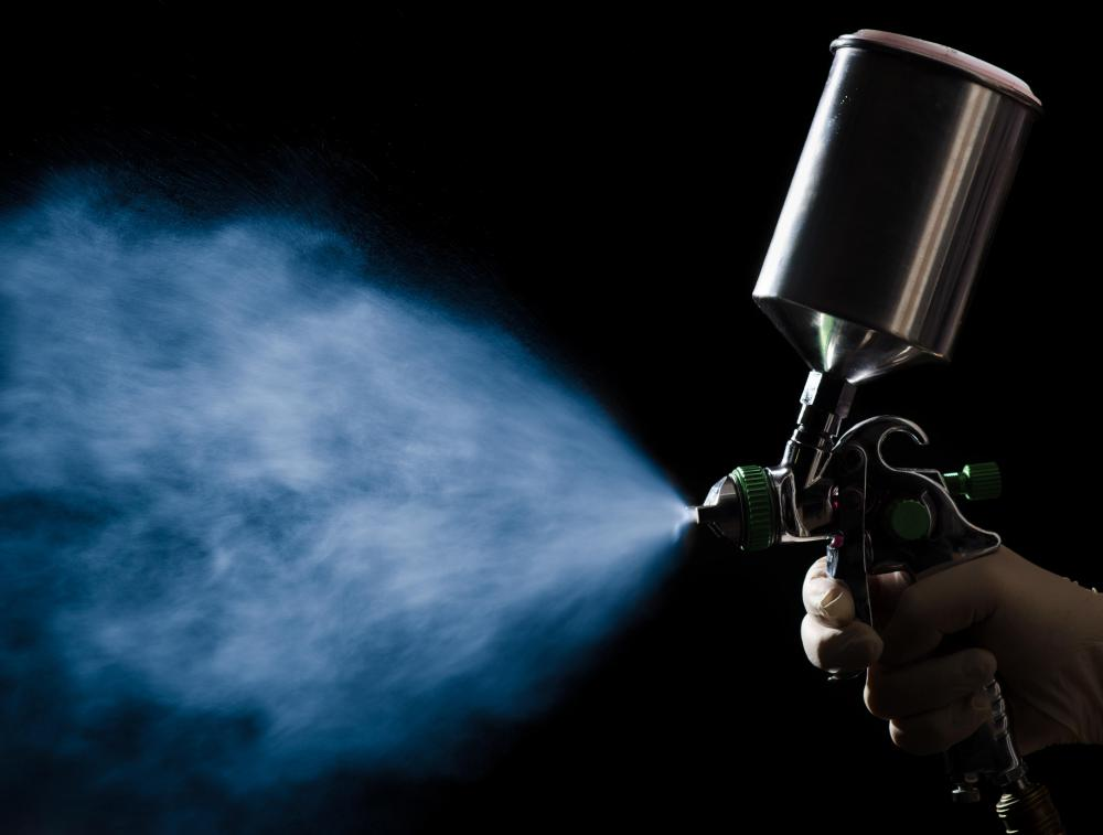 A spray gun may be used to paint an automobile.