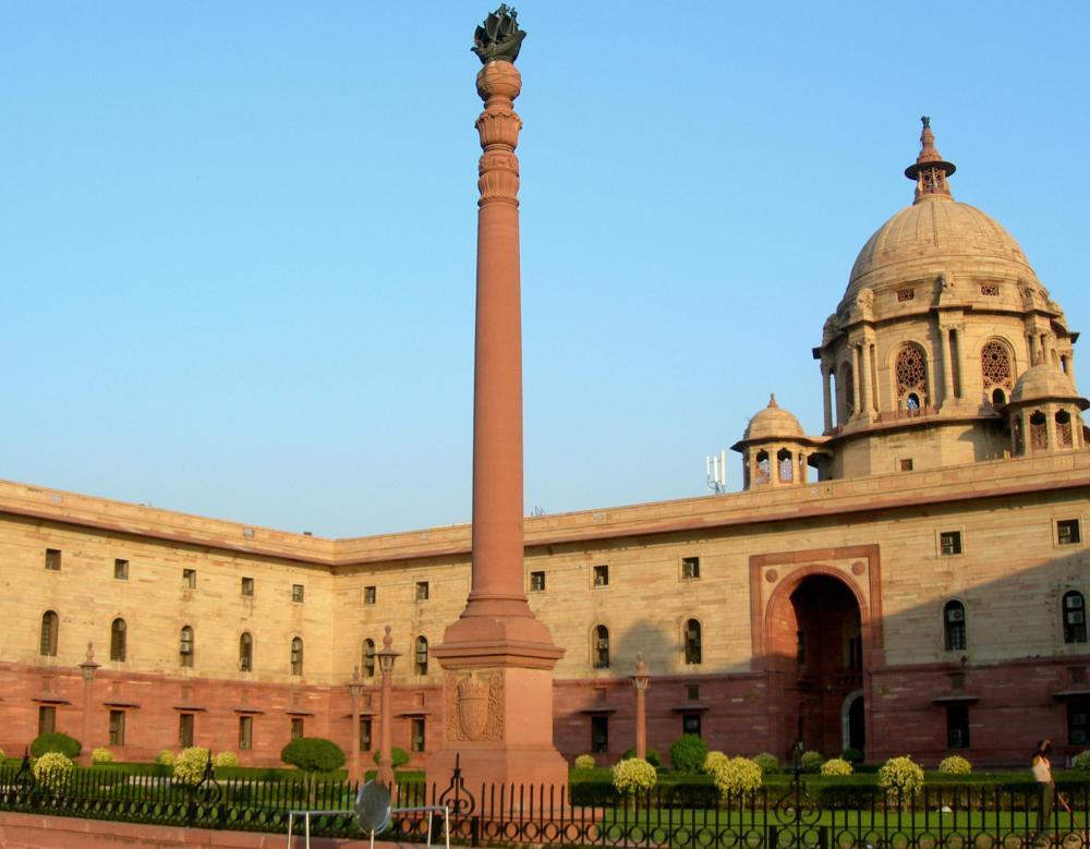 India bans those that hold an office of profit from being a member in the Indian parliament.