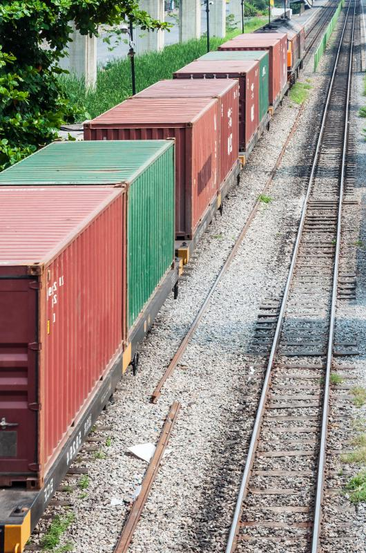 Intermodal containers are often transported by rail.