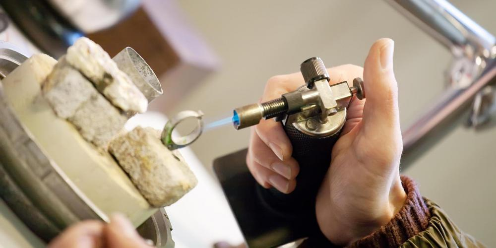 Jeweler resizing a ring.