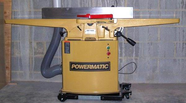 A jointer, which is used to make one side of a wooden board flat.