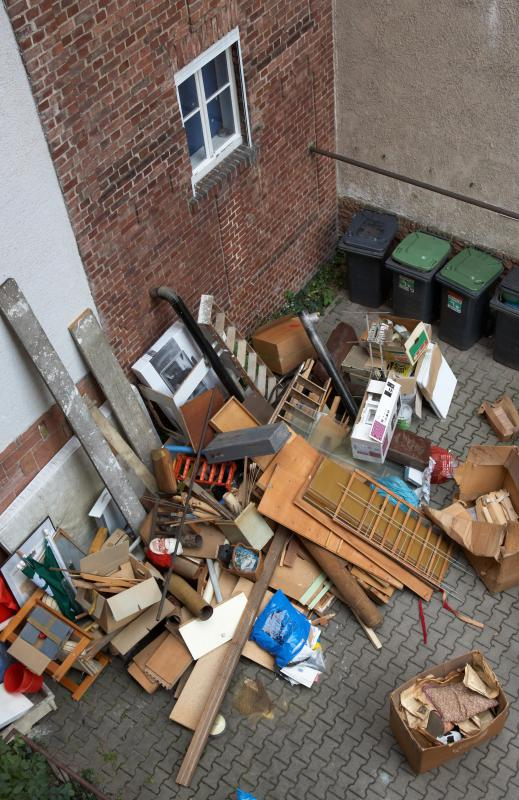 A fire prevention officer warns others about the hazards that clutter can create near a building.