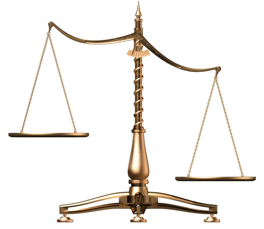 A beam scale is often used to represent the scales of justice.