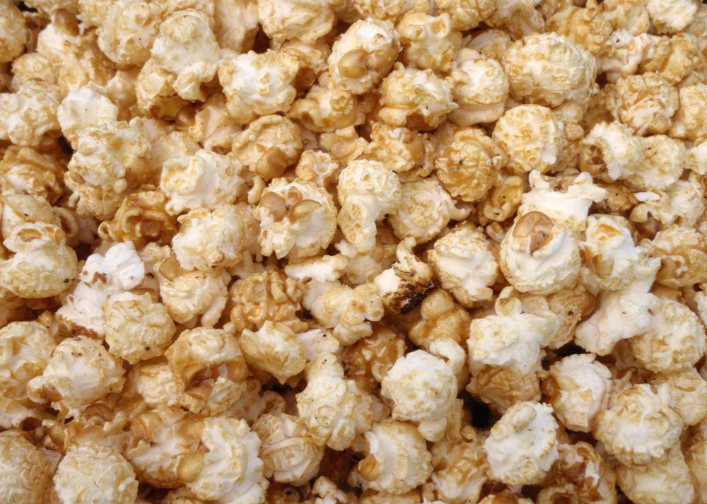 Kettle corn is made by popping corn kernels in an oiled kettle and ...