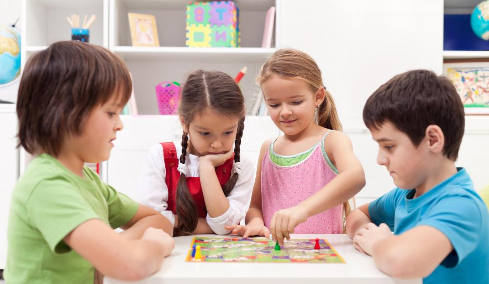 Group activities, such as playing board games, can help children develop social skills.