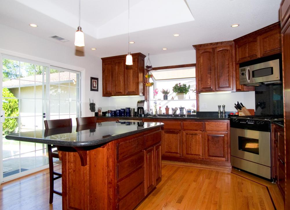 A kitchen island offers space to store pots and pans and a work area for  food preparation.
