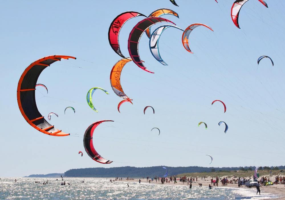 Kiteboarders may wear wetsuits if in cold waters.