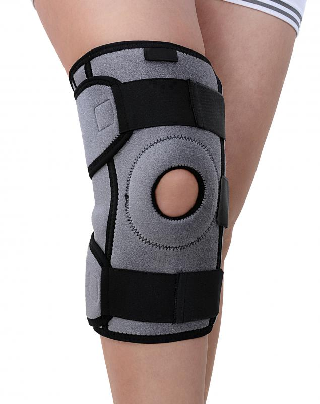 A person with a torn lateral meniscus wearing a knee brace.