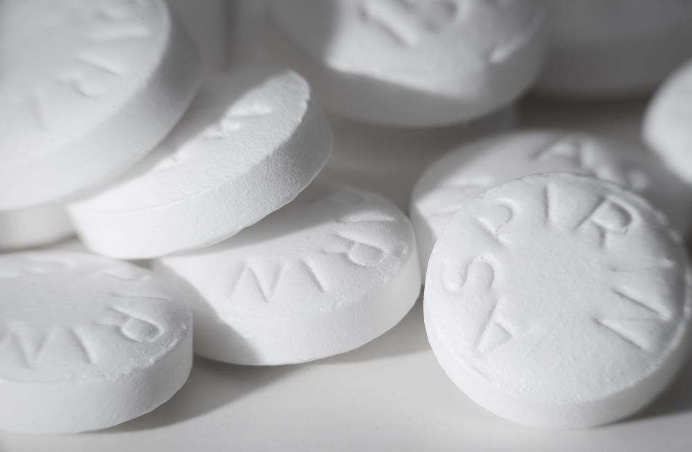 High doses of aspirin may cause bleeding ulcers.